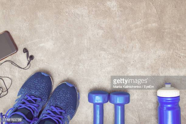 directly above shot of sports equipment on table - purple shoe stock pictures, royalty-free photos & images