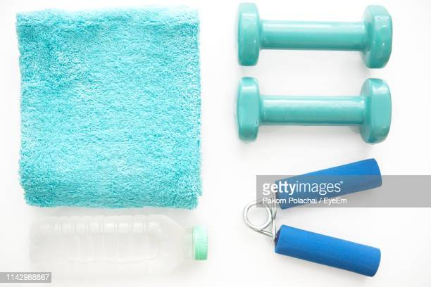 directly above shot of sports equipment with water bottle and towel on white background - エクササイズ用具 ストックフォトと画像