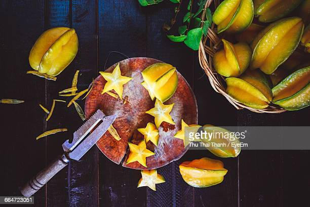 Directly Above Shot Of Starfruits And Knife On Table