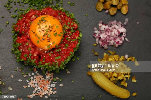 Directly Above Shot Of Steak Tartare And Pickles Served On Slate