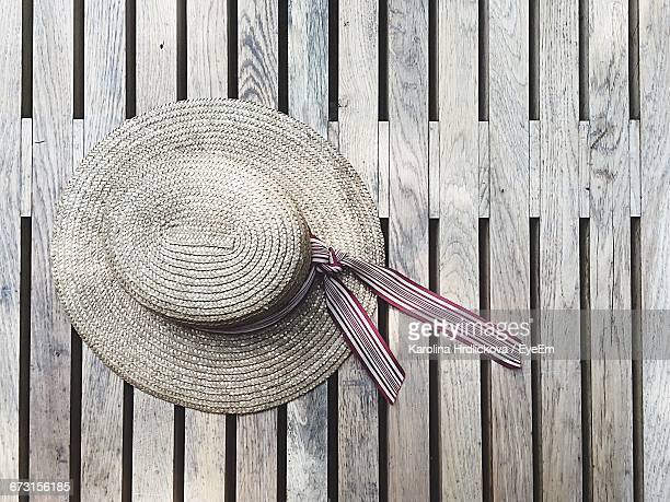 directly above shot of straw hat on table - 麦わら帽子 ストックフォトと画像