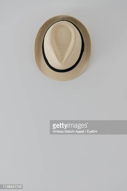 directly above shot of straw hat on white background - straw hat stock pictures, royalty-free photos & images