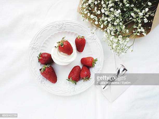 Directly Above Shot Of Strawberries On Cupcake In Plate