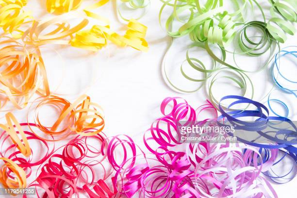 directly above shot of streamers on white background - streamer stock pictures, royalty-free photos & images