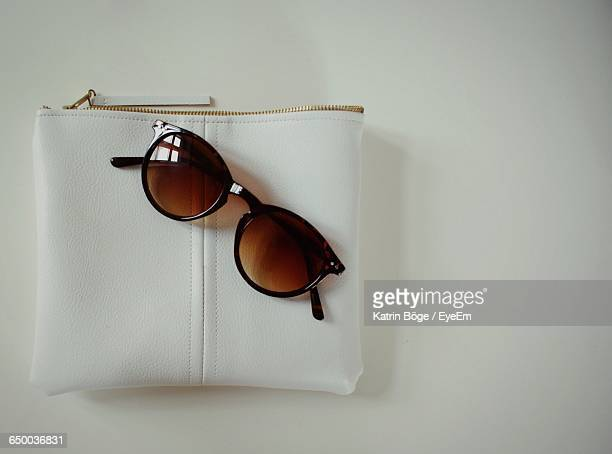 Directly Above Shot Of Sunglasses On Purse