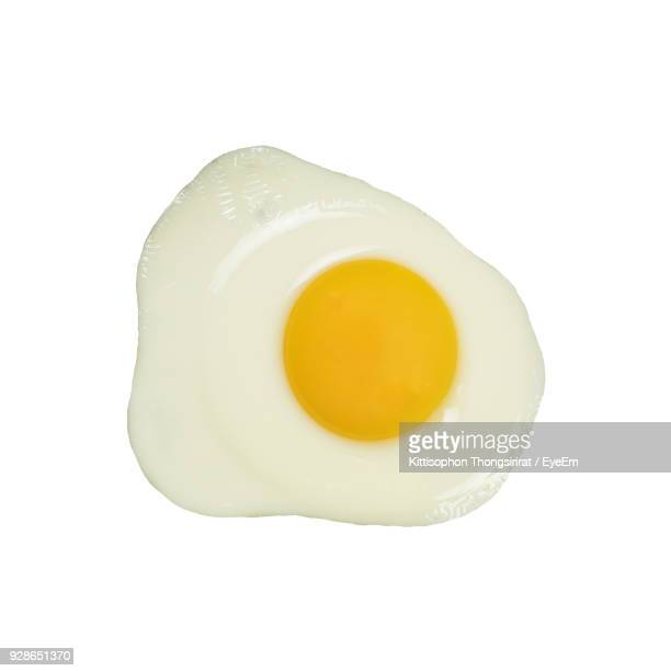 directly above shot of sunny side up over white background - egg white stock pictures, royalty-free photos & images