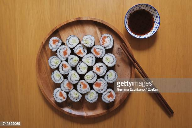 directly above shot of sushi served in plate with soy sauce on table - soy sauce stock photos and pictures