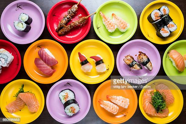 directly above shot of sushi served in plates on table - japanese food stock pictures, royalty-free photos & images