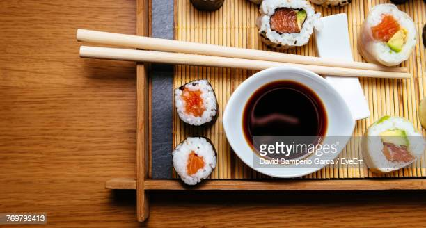 directly above shot of sushi served on table - soy sauce stock pictures, royalty-free photos & images