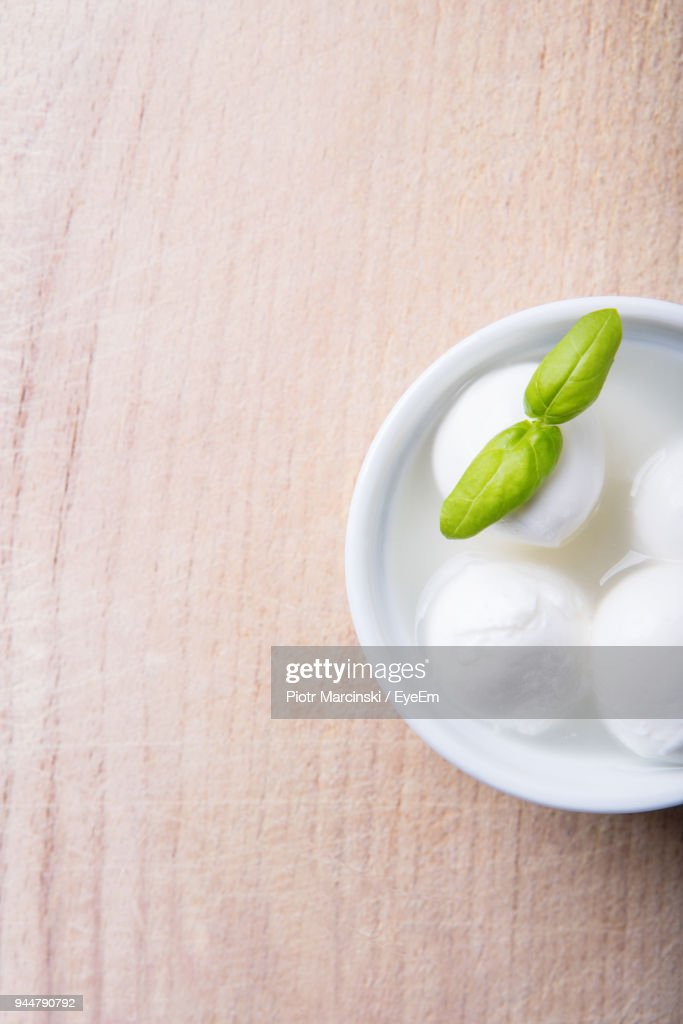 Directly Above Shot Of Sweet Food With Basil Leaves In Bowl On Table : Stock Photo