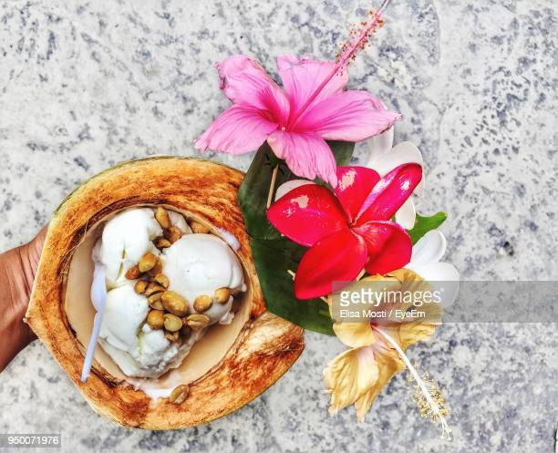 directly above shot of sweet food with flowers on table - ko samui stock photos and pictures