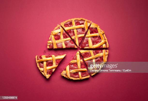 directly above shot of sweet pie on red background - slice stock pictures, royalty-free photos & images