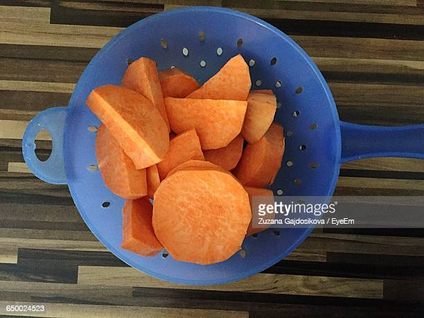 Directly Above Shot Of Sweet Potatoes In Container On Table
