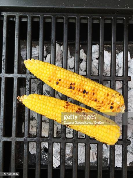 directly above shot of sweetcorns cooking on barbecue grill - metal grate stock photos and pictures