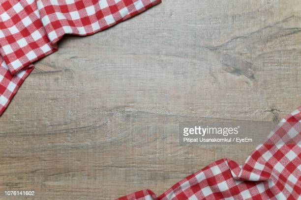 directly above shot of tablecloth on table - checked pattern stock pictures, royalty-free photos & images