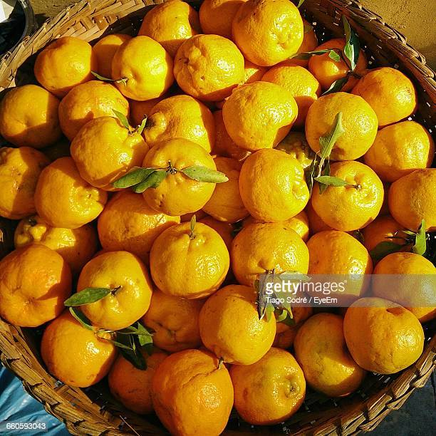 Directly Above Shot Of Tangerines In Basket At Market Stall