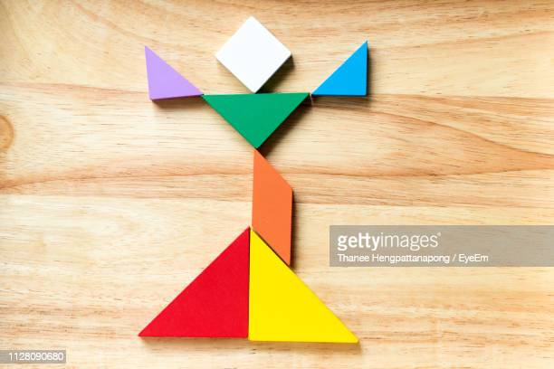 Directly Above Shot Of Tangram On Wood