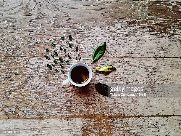 Directly Above Shot Of Tea Cup With Leaves Arranged