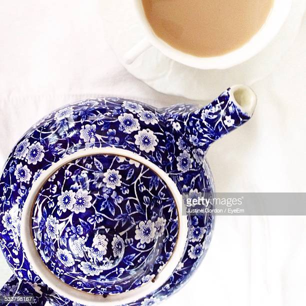 Directly Above Shot Of Teapot And Tea Cup On Table