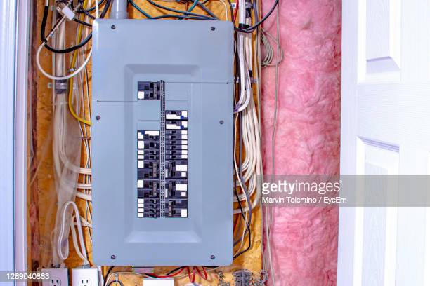 directly above shot of telephone pole against wall - electrical box stock pictures, royalty-free photos & images