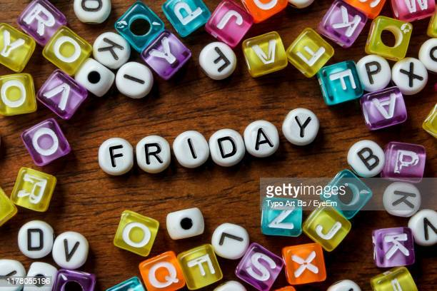 directly above shot of text beads on wooden table - friday stock pictures, royalty-free photos & images