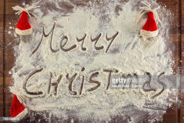 Directly Above Shot Of Text On Flour