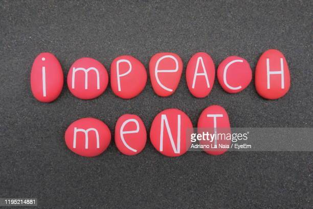directly above shot of text on stones - impeachment photos stock pictures, royalty-free photos & images