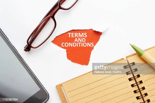 directly above shot of text with diary and smart phone on white paper - rules stock pictures, royalty-free photos & images