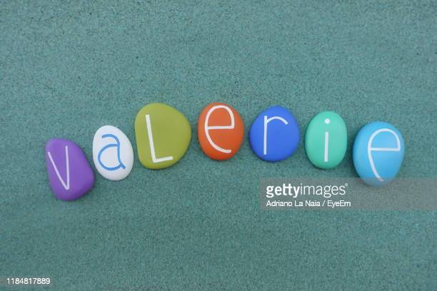 directly above shot of text written on multi colored stones - paris rocks stock pictures, royalty-free photos & images