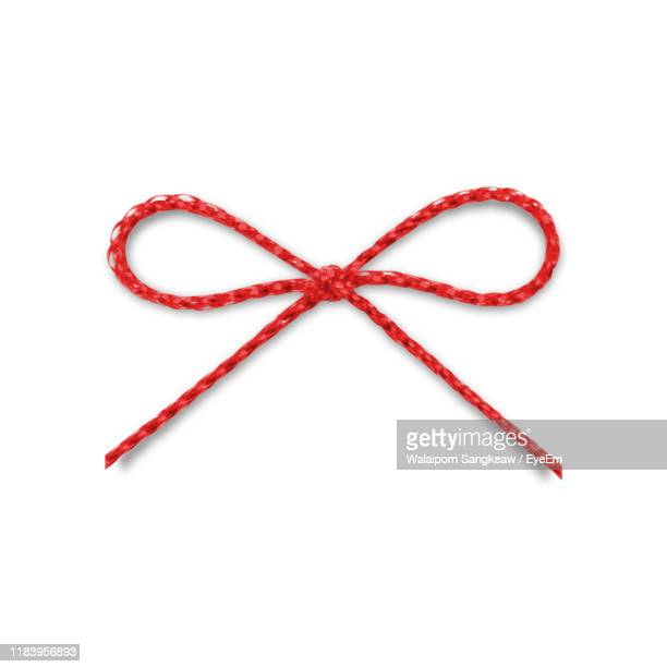 directly above shot of tied knot string on white background - string stock pictures, royalty-free photos & images
