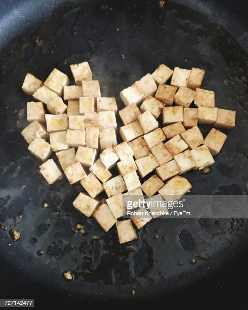 Directly Above Shot Of Tofu In Heart Shape On Frying Pan