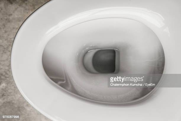 directly above shot of toilet bowl - toilet bowl stock photos and pictures