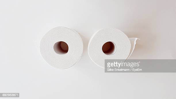 Directly Above Shot Of Toilet Paper Rolls On White Background