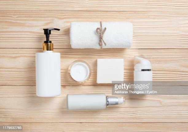 directly above shot of toiletries on table - toiletries stock pictures, royalty-free photos & images