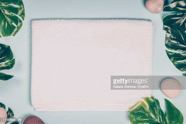 directly above shot of towel on table - towel stock pictures, royalty-free photos & images