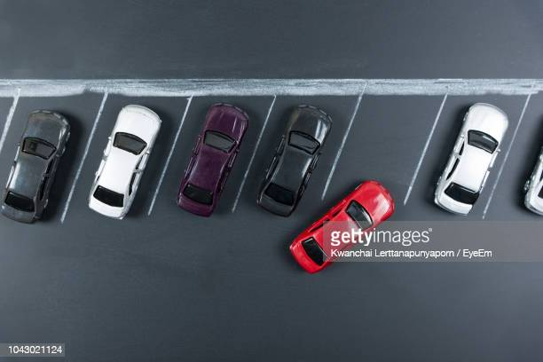 directly above shot of toy cars on table - car park stock pictures, royalty-free photos & images