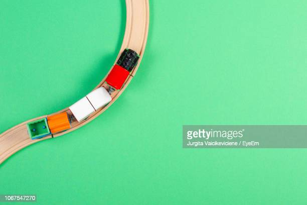directly above shot of toy train against green background - 模型の汽車 ストックフォトと画像