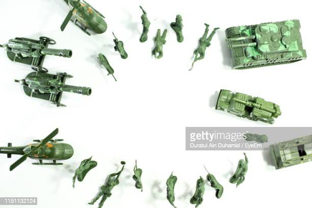directly above shot of toys against white background - army soldier toy stock pictures, royalty-free photos & images