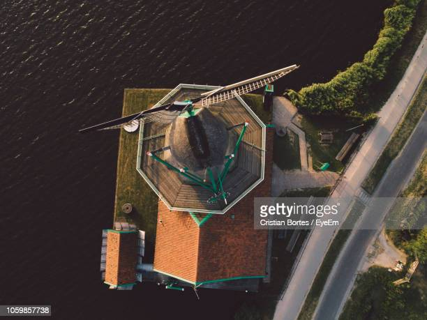 Directly Above Shot Of Traditional Windmill By River