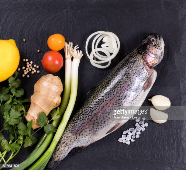 Directly Above Shot Of Trout With Ingredients On Table