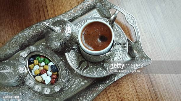 Directly Above Shot Of Turkish Coffee With Candies In Silver Tray On Table