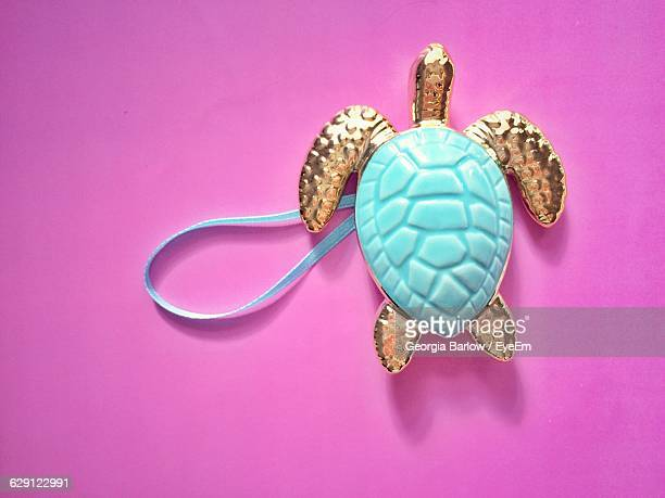 Directly Above Shot Of Turtle Figurine On Pink Table