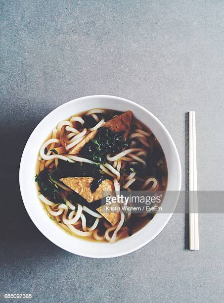 Directly Above Shot Of Udon Noodles And Chopsticks On Table