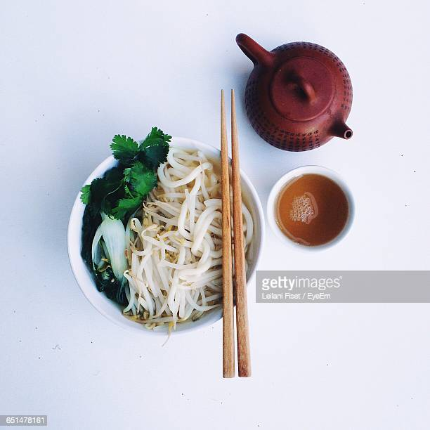 Directly Above Shot Of Udon Noodles Soup With Bean Sprouts By Green Tea