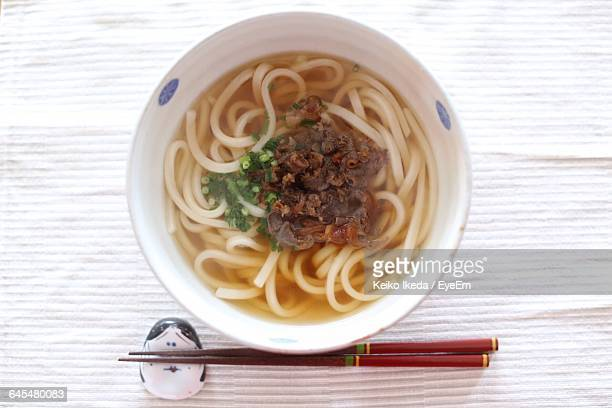 Directly Above Shot Of Udon Noodles With Chopsticks On Table
