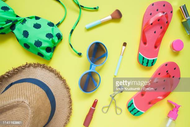 directly above shot of vacation equipment on yellow background - womenswear stock pictures, royalty-free photos & images