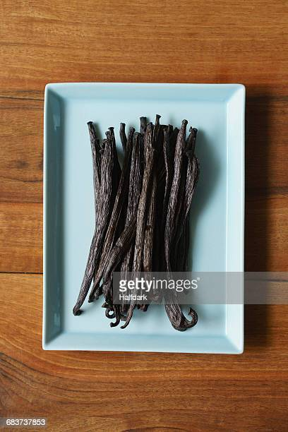 Directly above shot of vanilla pods in dish on table