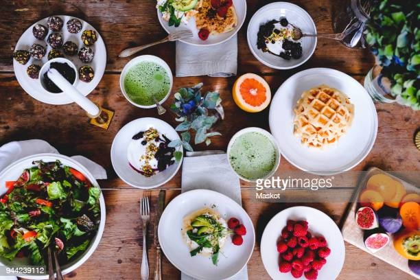 directly above shot of various food on wooden table - the brunch stock pictures, royalty-free photos & images