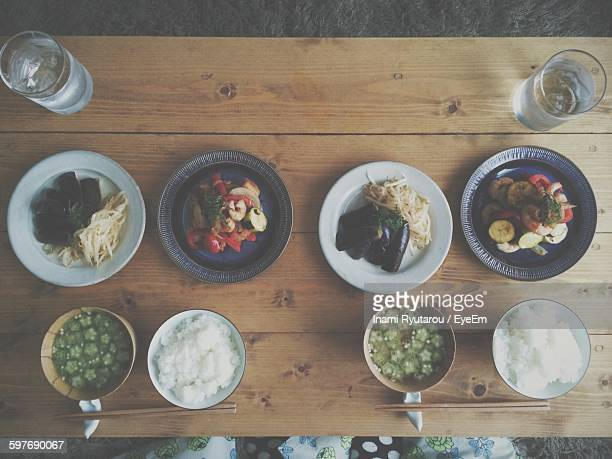 Directly Above Shot Of Various Food Served In Plate On Wooden Table