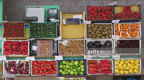 Directly Above Shot Of Various Fruits And Vegetables For Sale At Market Stall